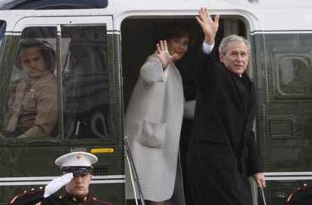 Former President George W. Bush and Laura Bush wave as they board a Marine helicopter at the Capitol in Washington after Barack Obama was sworn in as the 44th president of the United States, Tuesday, Jan. 20, 2009. (AP Photo/Charles Dharapak)