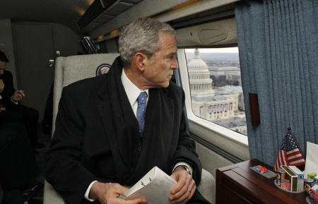 Former President George W. Bush looks out over the U.S. Capitol as his helicopter departs Washington, D.C. January 20, 2009, for Andrews Air Force Base following the inauguration ceremonies for President Barack Obama. (ERIC DRAPER/AFP/Getty Images)